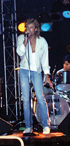 Price at the mic with his band back in the 1980s.