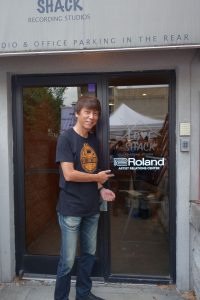 Yoshi Ikegami, President, BOSS Corporation, at the entrance to the Roland Nashville Artist Relations Center.